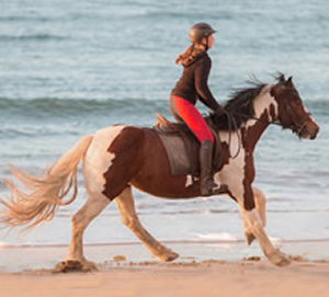 Girl riding on Trawalua Strand, Grange, Co Sligo
